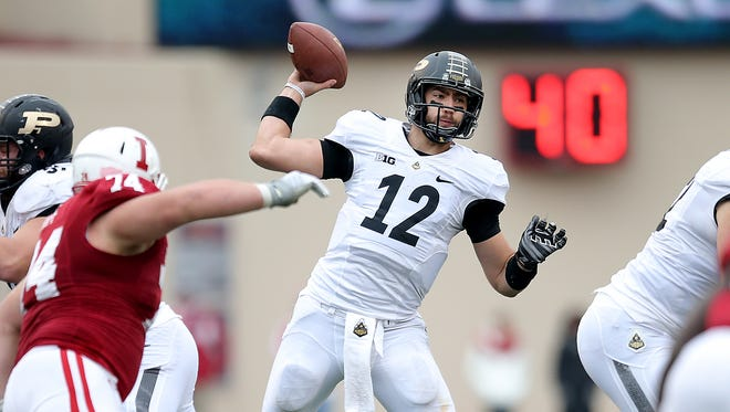 Purdue Boilermakers quarterback Austin Appleby (12) drops back to pass against Indiana during the Old Oaken Bucket game on Satuday, November 29, 2014, at Memorial Stadium in Bloomington.