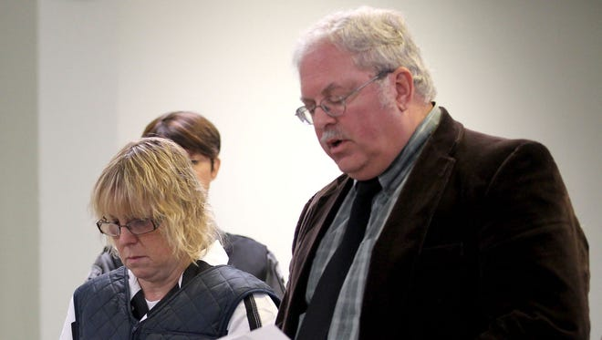 Joyce Mitchell stands with her lawyer Steven Johnston in Plattsburgh City Court for a hearing June 15, 2015.