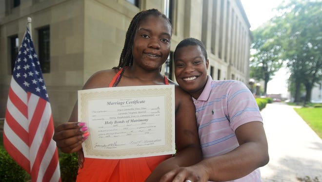 Laranda and Joyce Tines show off their rings and marriage certificate Monday. They are the first same-sex couple to have their wedding in Jackson-Madison County.