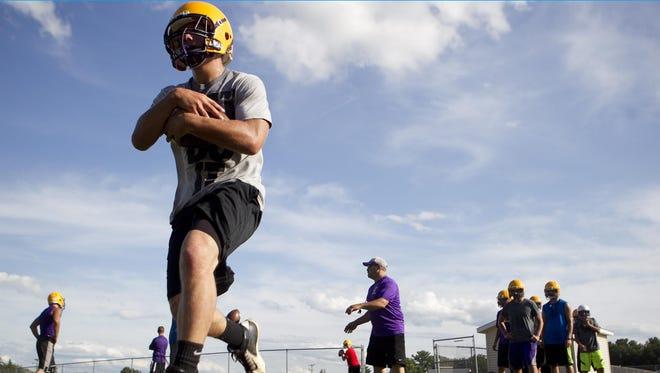 Alec Kolar runs through footwork drills during football practice at Pittsville High School, Aug. 5.