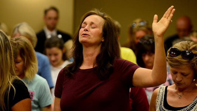 Sherry Hutcherson prays with about 200 others for law enforcement at the Chester County Justice Center Tuesday.