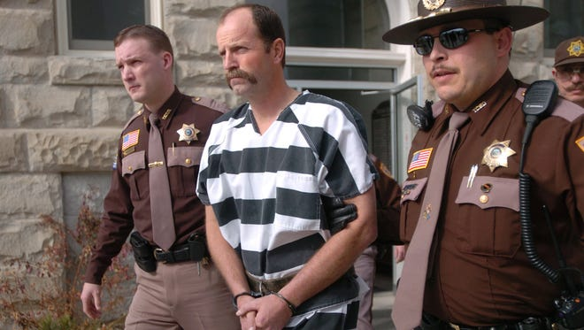 Kelly A. Frank is led from the Teton County Court House in Choteau in 2005 after pleading not guilty to plotting to kidnap David Letterman's 16-month-old son and his nanny and hold them for $5 million ransom.