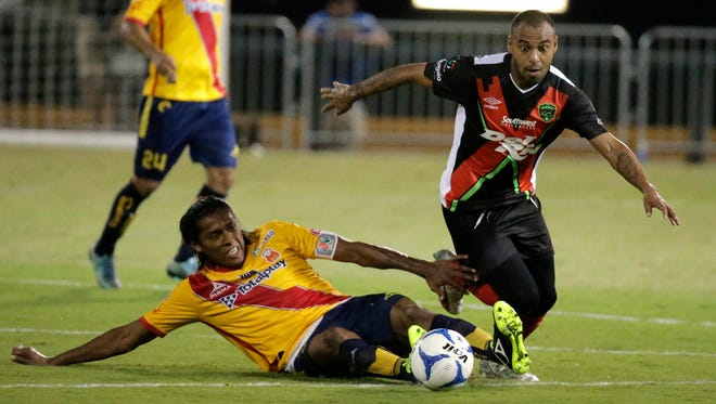 A member of the FC Juárez soccer team goes after a loose ball during action in their match against Monarcas Morelia team Friday night at Southwest University Park for the first soccer game played in the baseball stadium. The teams tied, 2-2. See more photos at elpasotimes.com.