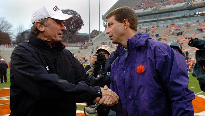 Then-Clemson interim head coach Dabo Swinney, right, shakes hands with South Carolina head coach Steve Spurrier prior to their first meeting Saturday, November 29, 2008 at Clemson's Memorial Stadium.