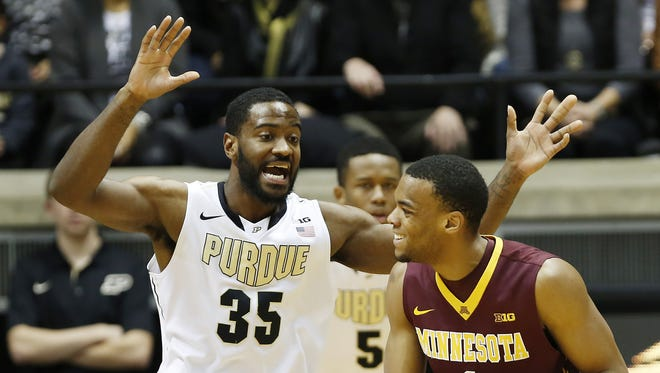 Rapheal Davis prevents a pass to the interior by Minnesota's Andre Hollins during a 2014 game at Mackey Arena.