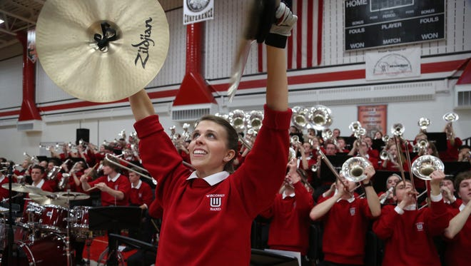 UW-Madison graduate Stephanie Miller plays the cymbals at Wausau East High School in March 2015.