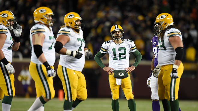 Green Bay Packers quarterback Aaron Rodgers (12) reacts after a missed opportunity against the Minnesota Vikings during Sunday's game at TCF Bank Stadium in Minneapolis, Minn.