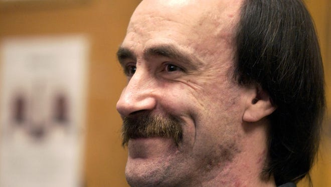 Jimmy Ray Bromgard smiles during a hearing finalizing his release at the Yellowstone County Courthouse on October 1, 2002. He was falsely convicted of rape in 1987.