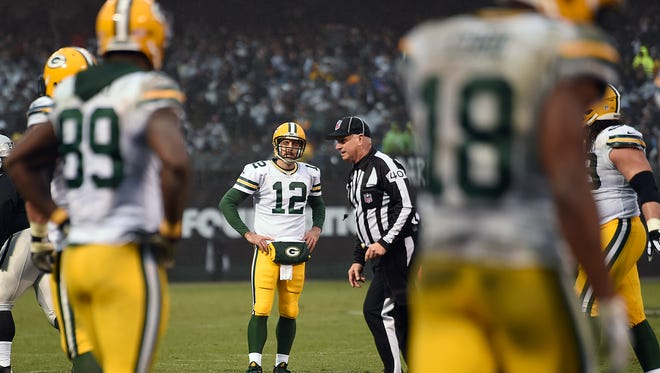 Green Bay Packers quarterback Aaron Rodgers (12) reacts after a missed opportunity against the Oakland Raiders in the fourth quarter at the O.co Coliseum.
