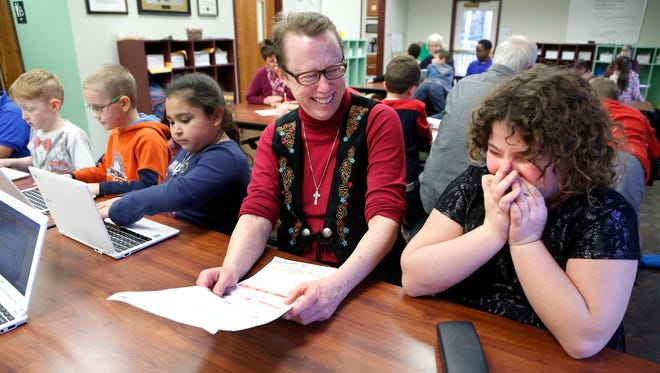 Cindy Eberts shares a laugh with Jordyn Eastridge, 9, Monday, January 11, 2016, at Lafayette Urban Ministry's Ray Ewry Youth Center, 525 N. Fourth Street in Lafayette. Eberts donated books to the Ray Ewry Youth Center to create the Eberts Memorial Library. The library is in memory of Eberts late husband, Ray Eberts, who was a Purdue University professor and director of continuing education.