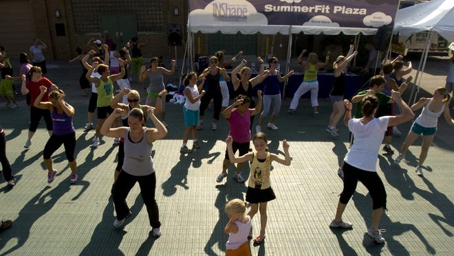 Families participate in a Zumba workout Aug. 8, 2010, at the INShape Indiana Summer Fit Plaza at the Indiana State Fair.