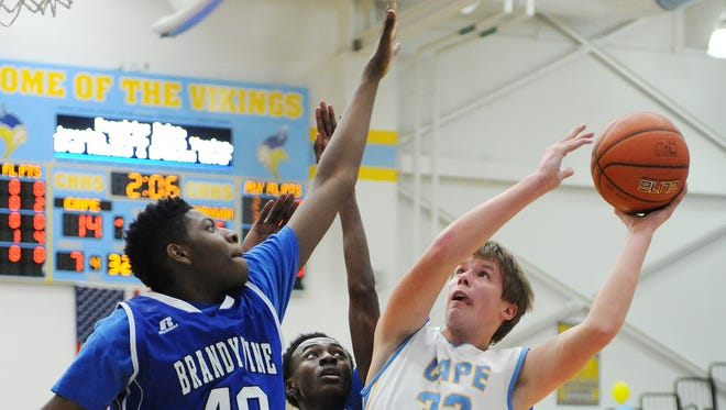 Cape's Ian Robertson goes for a shot over Brandywine's Nasir Williams and Ronald Powell as Cape Henlopen hosted Brandywine in a non-conference game at the school near Lewes on Tuesday. Feb. 23.