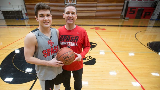 SPASH coach Scott Anderson, right, with his son, Trevor, during a 2016 practice.