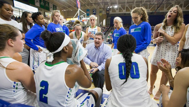 FGCU coach Karl Smesko leads a timeout against Jacksonville during play Sunday  in the Atlantic Sun Conference championship at Alico Arena in Fort Myers. Jacksonville beat FGCU 56-54.
