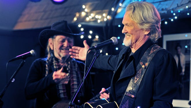 Willie Nelson, left, and Kris Kristofferson perform together at the Bluebird Cafe on Jan. 27, 2013. Kristofferson presented the first National Songwriters Association International's Kris Kristofferson Award to Nelson.