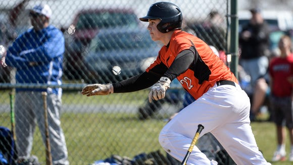 Palmyra's Tyler Julian heads for first after a hit