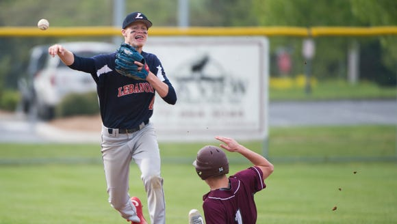 Lebanon's Logan Blouch turns the double play as Lebanon