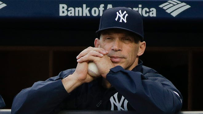 New York Yankees manager Joe Girardi (28) watches from the dugout during the first inning of a baseball game against the Kansas City Royals, Thursday, May 12, 2016, in, New York.