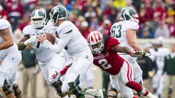 T.J. Simmons (2) closes in on Michigan State QB Connor Cook for a sack.