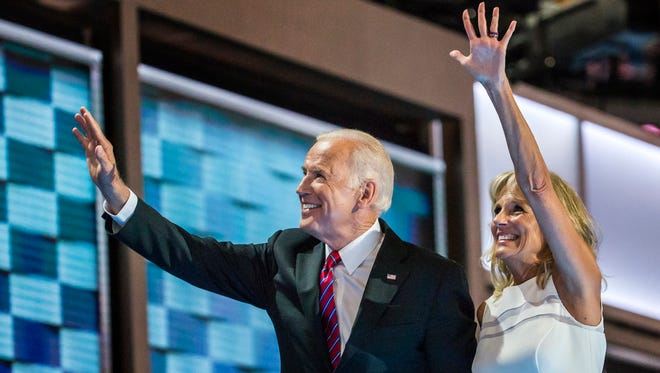Vice President Joe Biden and wife Jill Biden wave at the Democratic National Convention in Philadelphia on July 27. Biden's effort to accelerate cancer research may face new challenges with next president and in Congress.