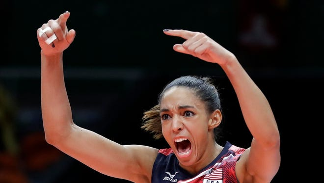 United States' Alisha Glass celebrates during a women's preliminary volleyball match against Italy at the 2016 Summer Olympics in Rio de Janeiro, Brazil, Friday, Aug. 12, 2016.