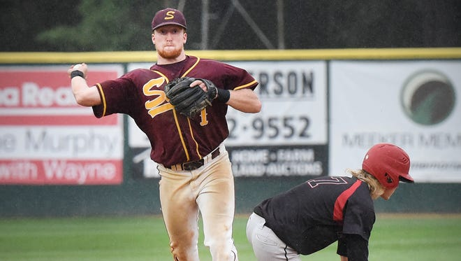 Sobieski's Collin Eckman tries unsuccessfully for a double play from second base after putting out Raymond's Brandon Wedel in the eighth inning Monday during the Class C State amateur baseball championship game in Dassel.