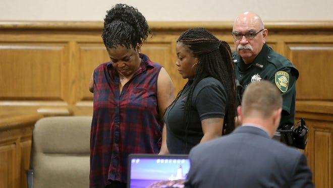 Mary Ann Greer, left, is helped off the stand after she testified Monday against her ex-boyfriend Michael Stitts, who is charged with her attempted murder. Greer lost her arm as a result of the shooting. Stitts' trial began Monday, Sept. 19, 2016, before Judge Roy Morgan at the J. Alexander Leech Criminal Justice Complex in Jackson, Tenn.