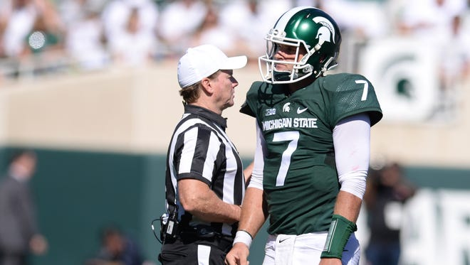 MSU Quarterback Tyler O'Connor reacts after being sacked during the Spartans' 30-6 loss against Wisconsin Saturday. O'Connor was sacked four times and threw three interceptions.