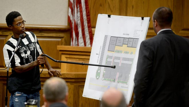 Demarcus Triplett points to a map depicting the Omni Center parking lot during the trial of Corbyn Davis, Tuesday afternoon. Triplett was a witness to the 2014 killing of Jamar Rogers. Davis is charged with first-degree murder and convicted felon in possession of a handgun.