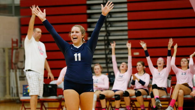 Central Catholic's Kacey Brickley and her teammates celebrate a point against West Lafayette Wednesday, September 28, 2016, at West Lafayette High School. Central Catholic defeated West Lafayette 23-25, 25-23, 25-21, 25-13.