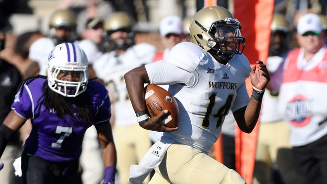 Wofford's Brandon Goodson (14) races to the end zone against Furman.