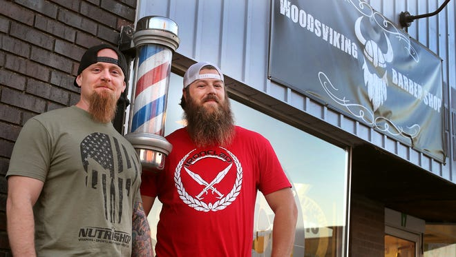 Aaron Dabney, left, and Shawn Templeton stand out in front of their shop Woodsviking Barbar Shop, on the square in Murfreesboro on Thursday, Nov. 17, 2016.