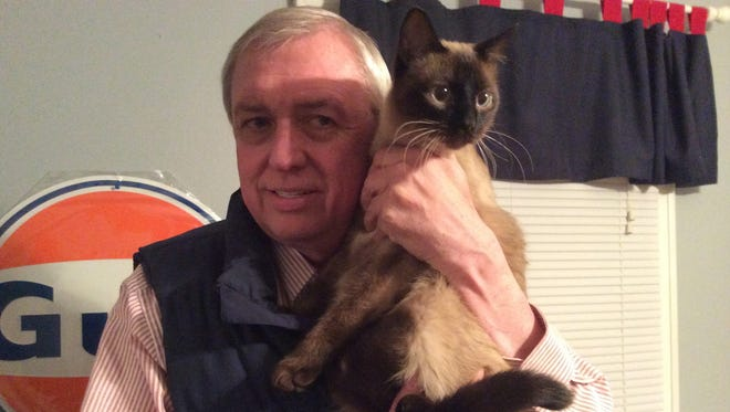 Mark Burger, a Gatlinburg, Tenn., resident, didn't get an evacuation alert on his phone Monday, Nov. 28, 2016. But his rescue cat, Tiger, made sure Burger knew something was wrong. Burger's house and business survived the fire.