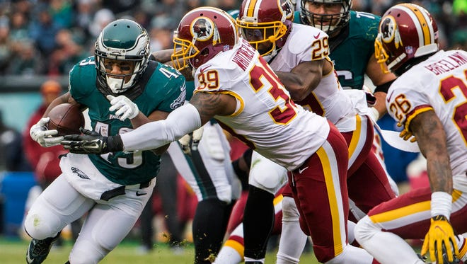 Eagles running back Darren Sproles (No. 43) is tackled by Washington safety Donte Whitner Sr. in the second quarter of the Eagles 27-22 loss to Washington last Sunday.