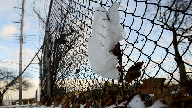 A plastic bag blows in the wind, stuck in a fence off Willow Street  ThursdayJan. 5, 2017 in Lansing.