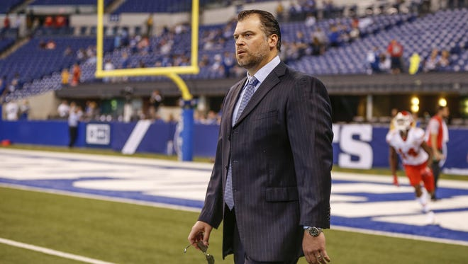 Indianapolis Colts general manager Ryan Grigson walks along the sidelines before the game against the Kansas City Chiefs at Lucas Oil Stadium on Oct. 30, 2016.
