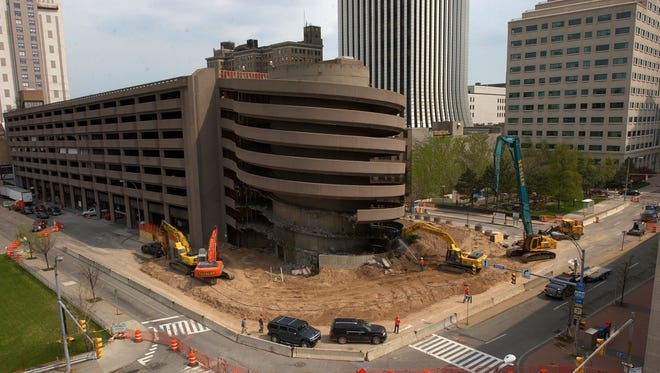 Demolition crews work on taking down the ground level of ramp from the South Avenue Garage Thursday morning at the start of the demolition of the ramp that fell.