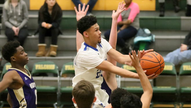 Olympic's Jaiden Mosley weaves his way to the basket in the first quarter against Highline in a West Central District 2A playoff opener Wednesday night at Foss High in Tacoma.