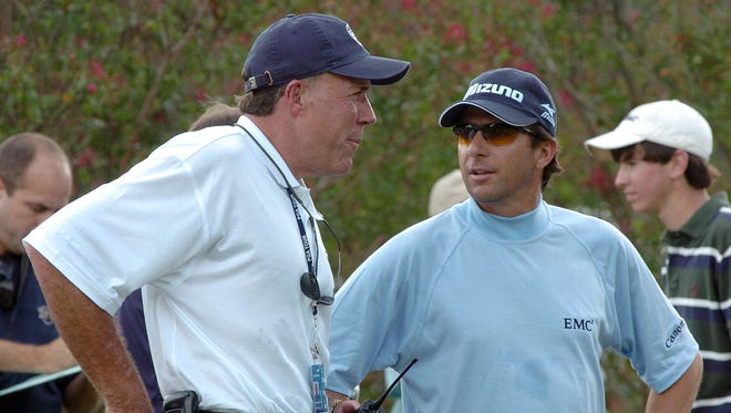 Randy Watkins (left) talks with pro golfer Billy Andrade of Bristol, RI., before the start of the 2007 Viking Classic Jr. Pro-Am. tournament at Annandale Golf Club in Madison.