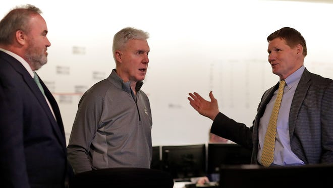 Green Bay Packers coach Mike McCarthy (left), general manager Ted Thompson (middle) and President/CEO Mark Murphy talk in the team's draft room at Lambeau Field during the 2017 NFL draft.