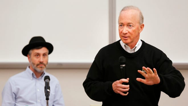 President Mitch Daniels answers question's concerning Purdue planned acquisition of Kaplan University during a special session of the University Senate Thursday, May 4, 2017, in Forney Hall of Chemical Engineering. Listening to Daniels is David Sanders, Chairman of the University Senate.