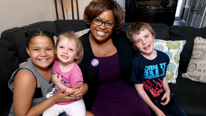 Michelle Thomas is a single mom to Jorie, far left, and she also opens her home to foster children, including the two she has now, Marjorie and Chris.