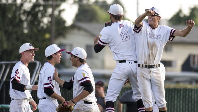 Mt. Whitney's Carter Johnson, right, and pitcher Philip Dinis leap to celebrate their win over Hanford in a Central Section Division II semifinal on Wednesday, May 24, 2017.
