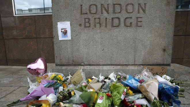 A floral tribute in the London Bridge area in London on Monday, June 5, 2017. Police arrested several people and are widening their investigation after a series of attacks described as terrorism killed several people and injured more than 40 others in the heart of London on Saturday, June 3, 2017.