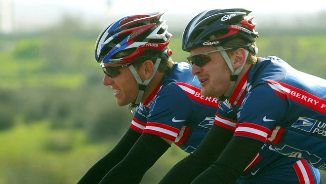 In this 2004 file photo, Lance Armstrong, left,  and Floyd Landis, ride as members of the U.S. Postal Service cycling team.