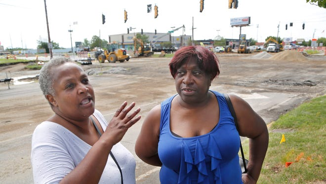 """Bernadette Wimberly, left, and Sandra Caldwell talk Friday, July 21, 2017, about the construction that has closed the intersection of South Street and Sagmore Parkway (background) in Lafayette. Wimberly, Lafayette, and Caldwell, West Lafayette, said they try to avoid the area because of the construction. """"It (the construction) sounds like a good idea, it's just so inconvenient,"""" said Caldwell."""