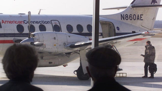 In this file photo from Jan. 14, 2004, Irene Stephens (left) and Don Martin watch as her son John boards an AmericanConnection flight at Purdue University Airport in West Lafayette, Ind. Commercial airline service ended at the airport a month later.