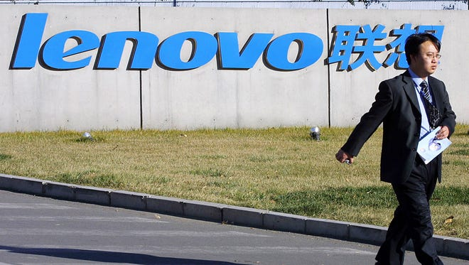 A man walks past the Lenovo headquarters in Beijing, China.