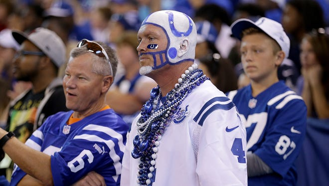 Dejected Colts fans look on late in the second half of their game at Lucas Oil Stadium Sunday, Sept, 17, 2017. The Colts lost to the Cardinals 16-13 in overtime.