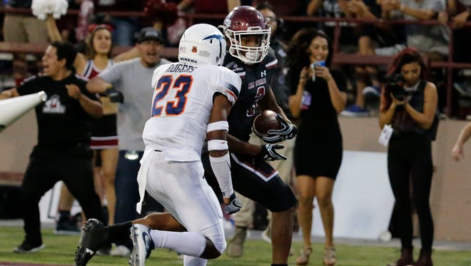 NMSU running back Larry Rose III gets the ball across the goal line for another Aggies touchdown making the score 21-7 to go into the half with the lead.
